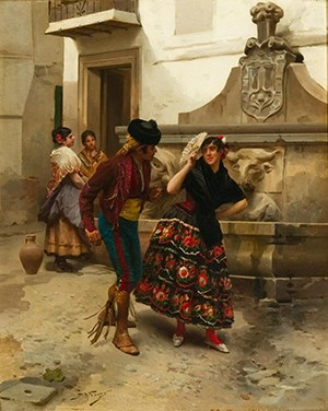 A brightly dressed Spanish couple in a courtyard.