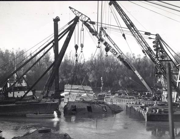 cranes raising the uss cairo