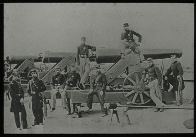 Union soldiers pose in front of a cannon