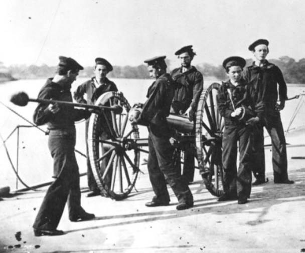 navy crew manning a howitzer on land