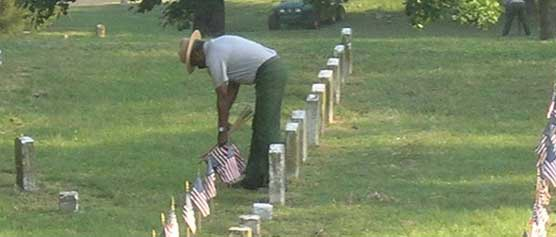 Placing Flags in Vicksburg National Cemetery