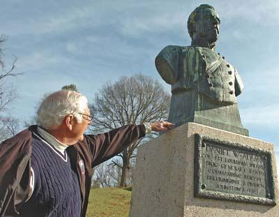 Executive director Harry McMillin of the newly formed Friends of the Vicksburg National Military Park and Campaign points out a bust of Confederate Col. Daniel W. Adams as an example of a monument in need of cleaning.