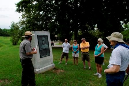 Park Ranger giving a talk at a battlefield marker
