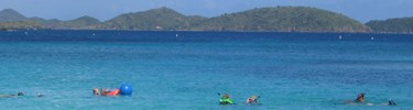 Photo of snorkelers at Trunk Bay.