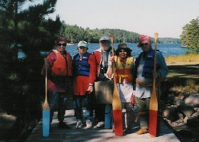 Park volunteers stand with canoe paddles in hand after leading a guided North Canoe trip in the park.