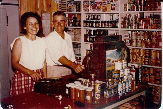 Historic photo of Ted and Fern Monson standing next to a register at their resort in Hoist Bay.
