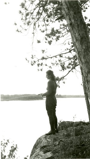 Historical Photo:  Lady fishing from rock