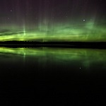 The northern lights shine in the night sky