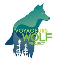 The logo of the Voyageurs Wolf Project depicts a wolf looking to the right, with the tops of pine trees silhouetted its feet
