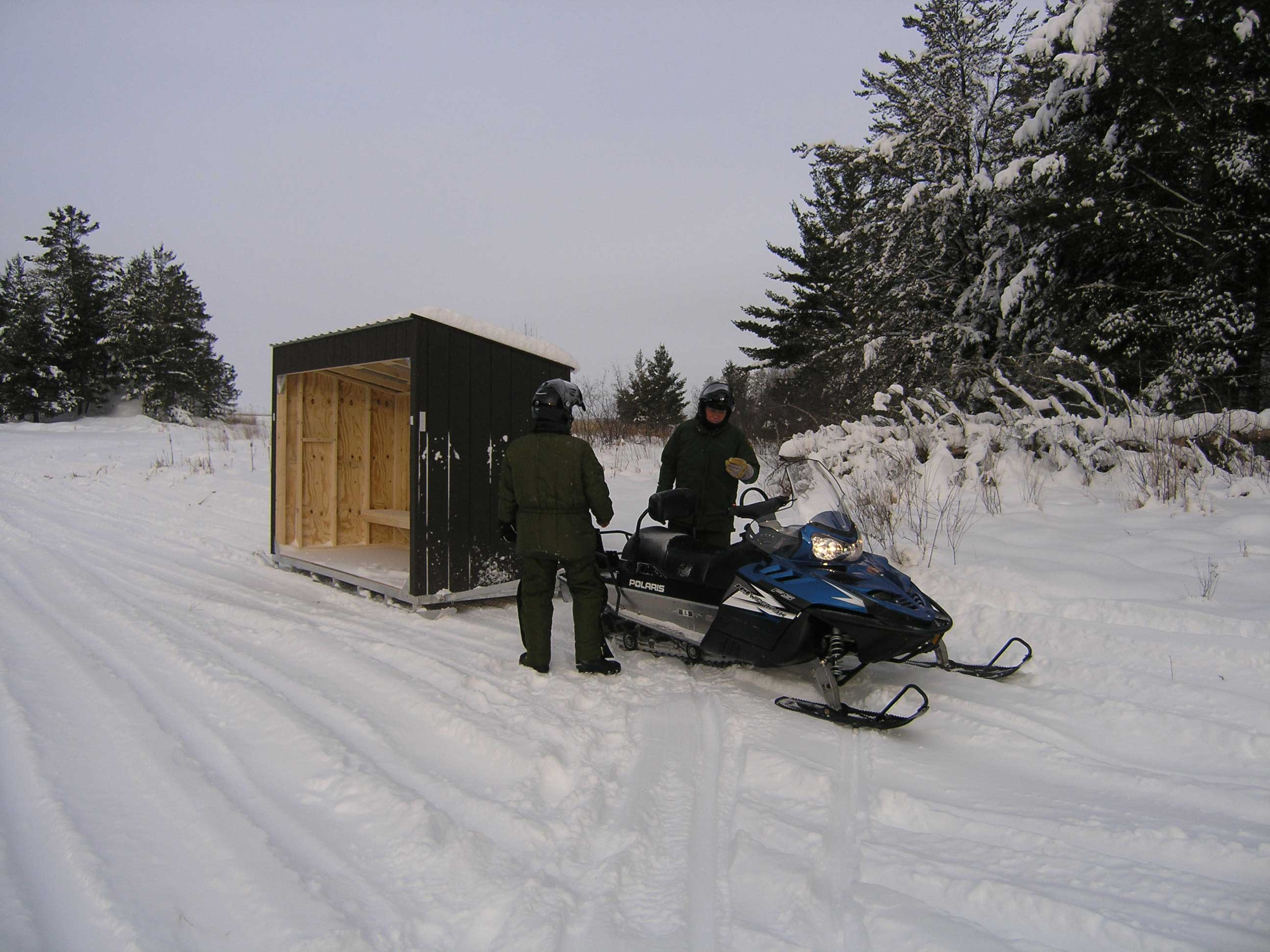 Rangers delivering a Shelter with Sled