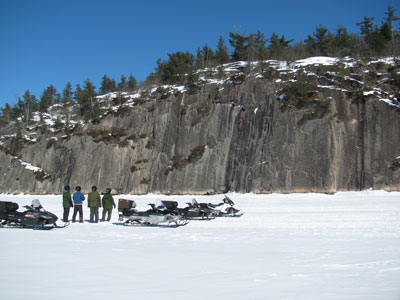 Snowmobiling to Grassy Bay Cliffs