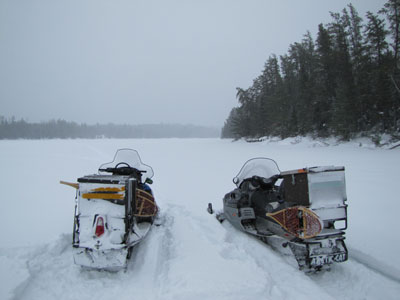 Snowmobiling on Locator Lake