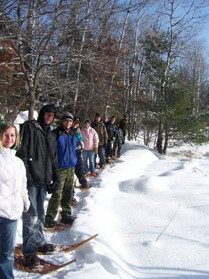 People enjoying a snowshoe hike.