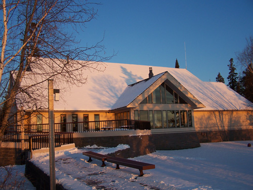 Lakeside of the Rainy Lake Visitor Center with the sunrise on it