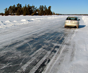 Car parked along the Rainy Lake Ice Road.
