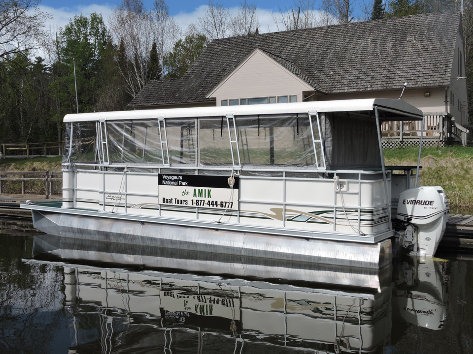 Amik tour boat docked in front of the Kabetogama Lake Visitor Center