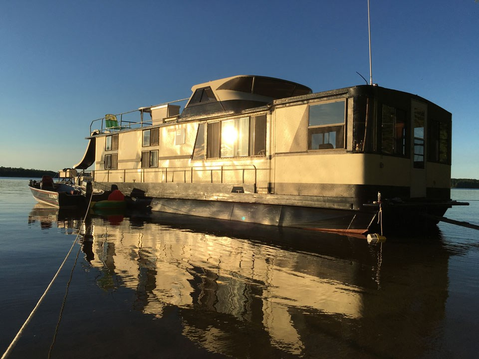 Houseboat With Sunset Hitting The Side Of It