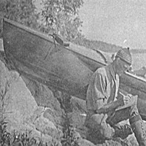 I.W. Stevens sitting by his boat.