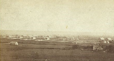 1867 Photograph of Fort Riley, Kansas, showing cluster of buildings on wide open Great Plains