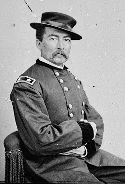 General Sheridan, from 1860's photograph shows him with mustache and arms folded.