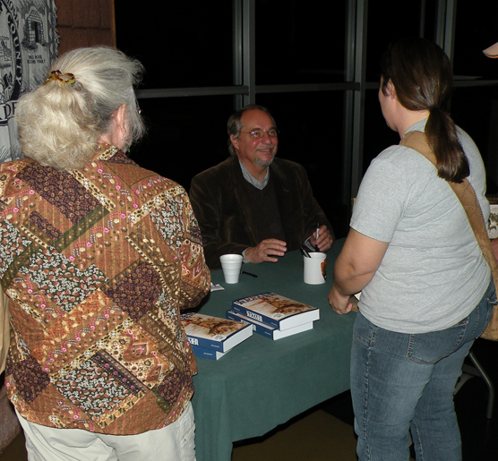 Dr. Paul W. Hutton visiting with guests.