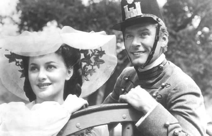 Errol Flynn and Olivia de Havilland in the film being shown at Washita's Movies in the Park.