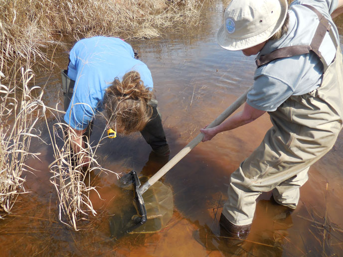Kim Shaw, Blue Thumb Quality Assurance Officer (left) and-Beckey Smith, former Teacher Ranger Teacher, collected creek bugs in the Washita River last March.