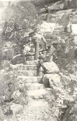 CCC worker on stone steps
