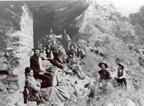 Group of people dressed in their Sunday best at a cliff dwelling