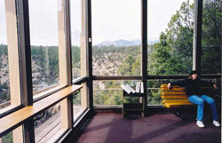 View of canyon and mountains through visitor center windows