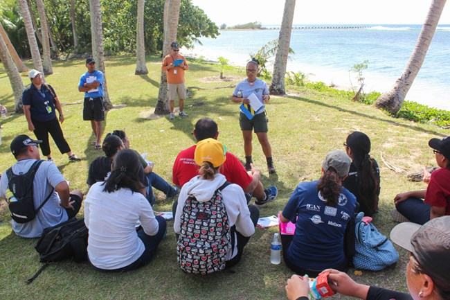 Teachers join a park ranger at Ga'an Point to learn about the unique resources of War in the Pacific NHP.