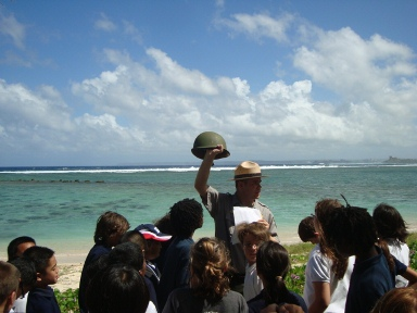 Students and a park ranger at Asan Beach, Guam.