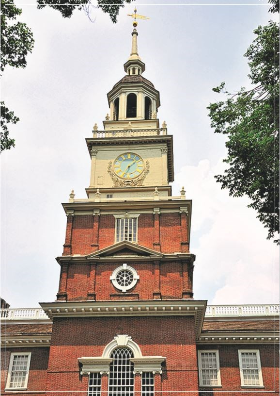A multi-story red brick clock tower