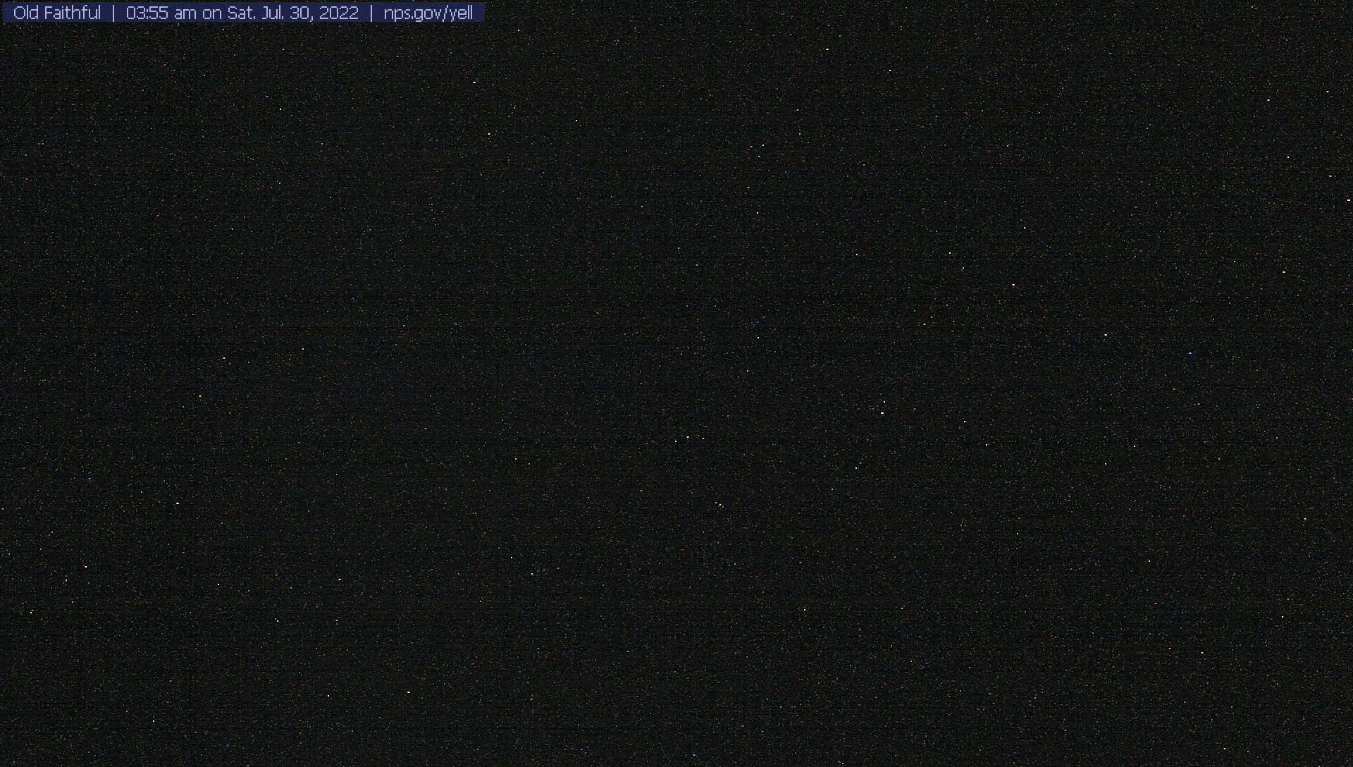 View of Old Faithful Geyser as seen through the front of the visitor education center.