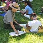 The park's Teacher-Ranger Teacher paints with students.