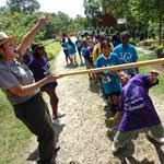 Students participate in a rousing game of Paintbrush Limbo!