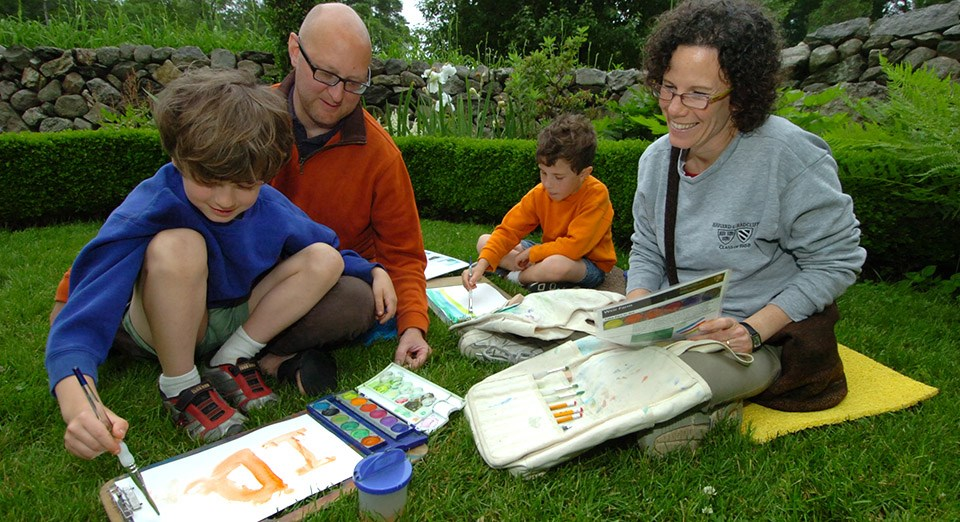 A family enjoys painting in the park
