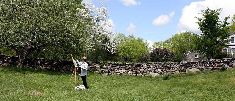 Artist painting in spring