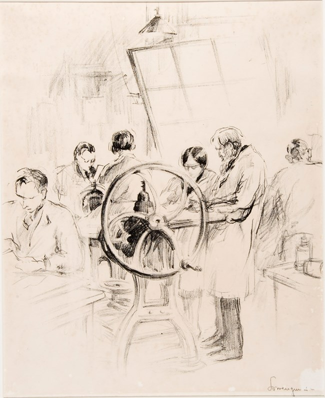 Lithograph in on white paper.  An older man in classroom is standing next to a printing press teaching a woman next to him.