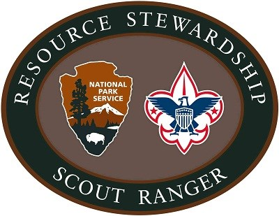 Image of Boy Scout patch for resource stewardship; green and gray oval with seals.