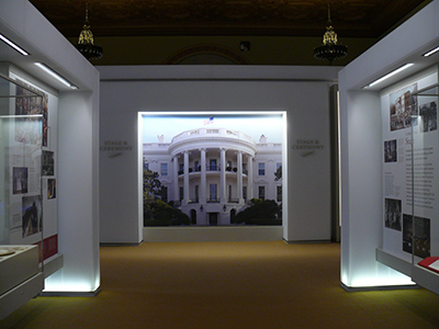 White House Visitor Center Exhibit Space with large image of South Front Portico in center.