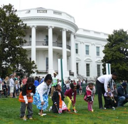 Children rolling Easter eggs on South Lawn