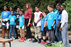 Melania Trump and Boys and Girls Club members smile for a photo.