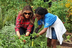 First Lady Melania Trump Harvests Vegetables With A Teenager.