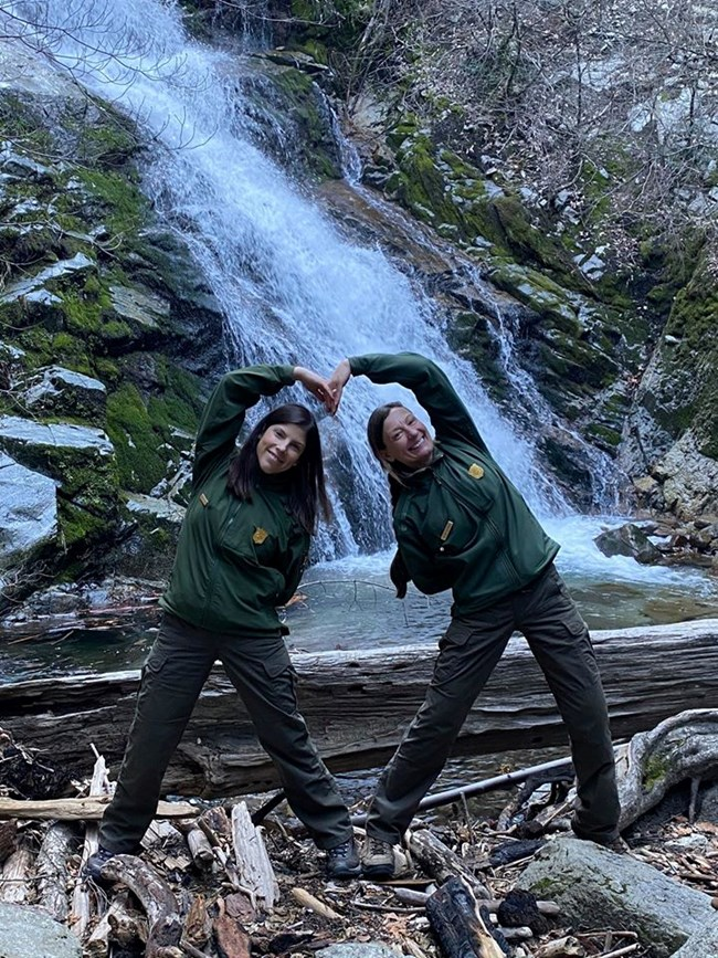 Showing their love and excitement for the reopening of Whiskey town Falls on Valentine's Day 2020, park staff create a heart shape with their bodies.