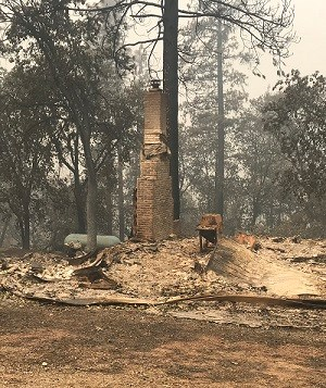 Remains of house burned by Carr Fire