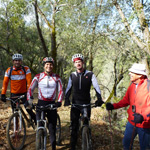 Mountain bikers and a hiker enjoying the Kanaka Peak Trail