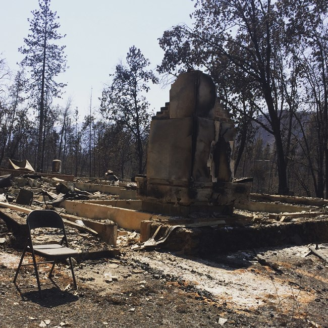 The remains of a park residence after burning to the ground in the Carr Fire. NPS Photo.