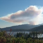 smoke column visible over lake