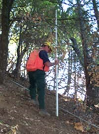 NPS Fire Ecologist monitoring a prescribed burn unit.